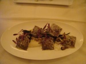 Porcini Ravioli served over asparagus