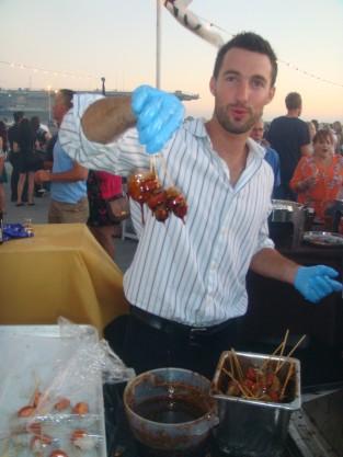 Chef prepaing glazed shrimp in San Diego