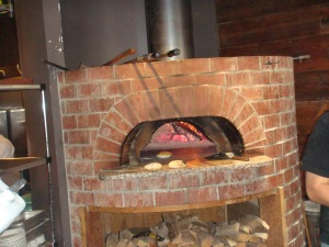 Wood Fired Pizza Oven where they prepare the bread for the Puccia Meatball Sandwich at Oven and Shaker