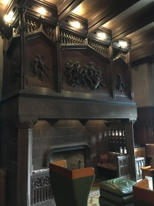The gorgeous Fireplace in the lobby is surmounted by bas-relief football players.