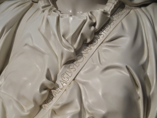 "Image result for Pieta Michaela[n]gelus Bonarotus Florentin[us] Facieba[t]"" (""Michelangelo Buonarroti of Florence Made It"") onto the sash across Mary's chest."